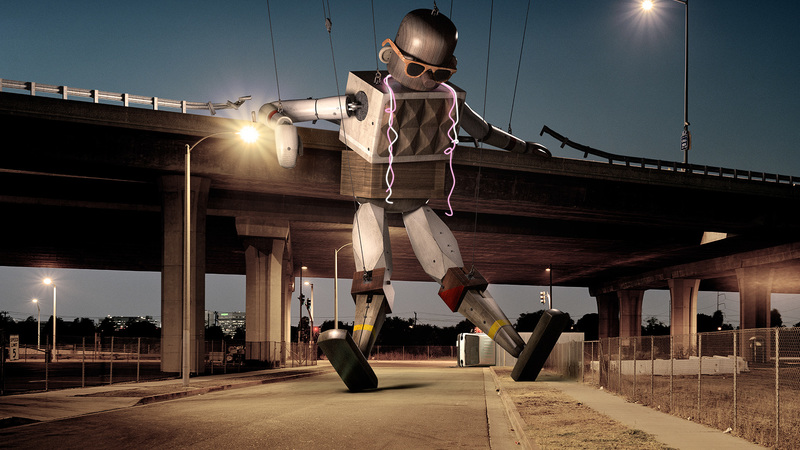 Illustration of 3d Robot composited into a photograph of a flyover at night.